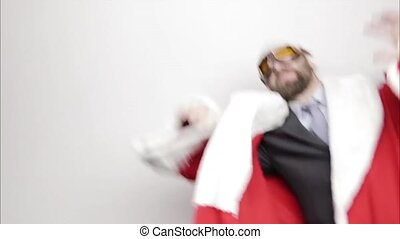 businessman in a suit of Santa Claus smiling and funny dancing,