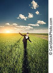 Businessman in a wheat field