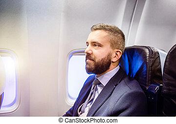 Businessman in airplane