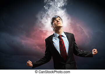 businessman in anger with fists clenched and steam above...