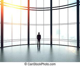 businessman in big sunlight office