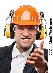 Businessman in black suit and safety hardhat helmet gesturing hand greeting or meeting handshake white isolated