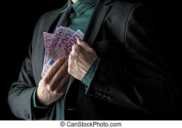 Businessman in black suit holding 500 euro bills
