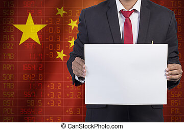 businessman in black suit holding sign empty on Flag of China Business Concept