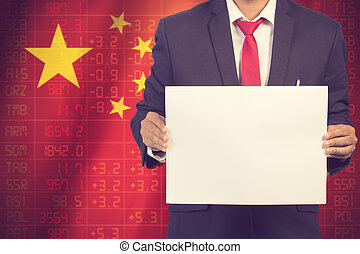 businessman in black suit holding sign empty on Flag of China Business Concept. Vintage color