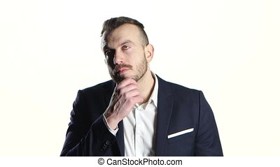 Businessman in black suit thoughtful and rubs his hand beard