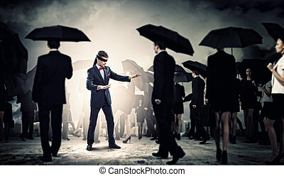 Businessman in blindfold among group of people - Image of ...