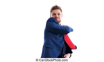 Businessman in blue suit dances happy. Shot over white...
