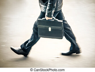 businessman in blurry walking