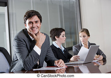 Businessman in boardroom with female colleagues