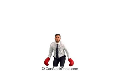 Businessman in boxing gloves jumping and punching his fists...