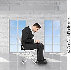 businessman in brick room