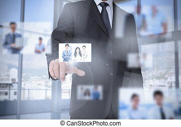 Businessman in bright office presenting digital interface