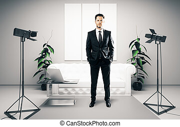 Businessman in bright room with lamps