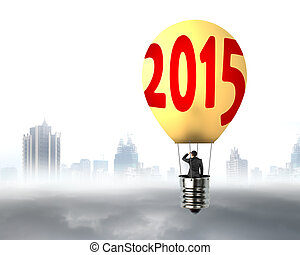 businessman in brightly yellow lamp 2015 hot air balloon flying