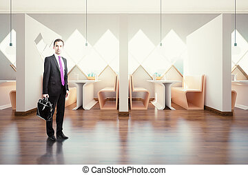 Businessman in cafe interior