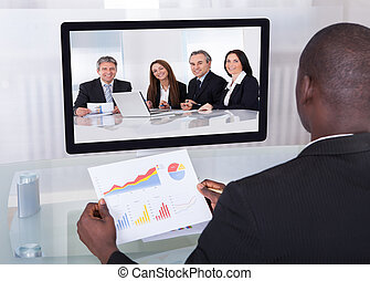 Businessman In Conference Analyzing Graph