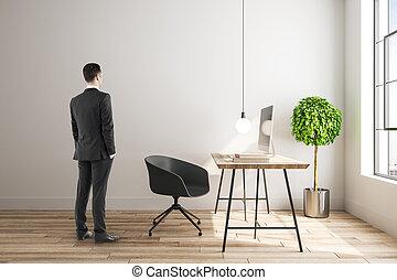 Businessman in contemporary interior