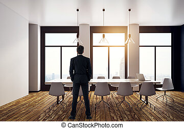 Businessman in contemporary meeting room