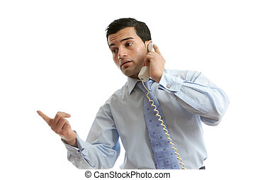 Businessman in conversation on telephone