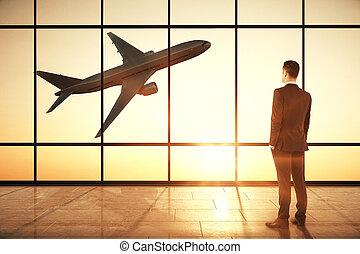 Businessman in creative airport interior