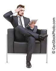 businessman in danger with device on a white background