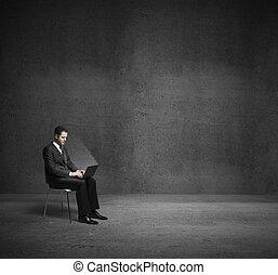 businessman in dark room