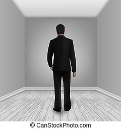 Businessman In Empty Room With Laminate Floor
