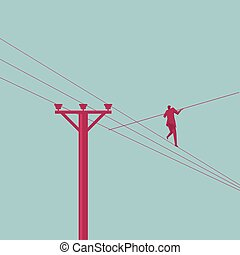 Businessman in equilibrium on the cable. Business concept.