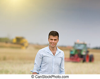 Businessman in field during harvest