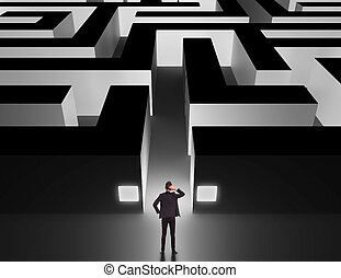 Business man in front of a huge maze thinking how to get through