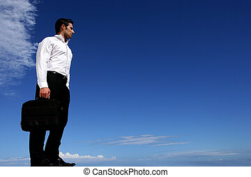 Businessman in front of blue sky