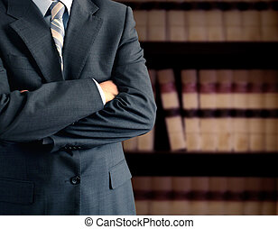 Businessman in front of bookcase - Businessman wearing a...