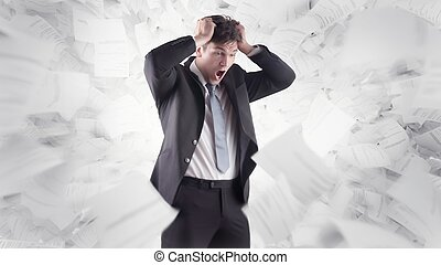 businessman in front of white background and flying paper