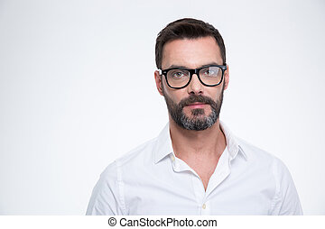 Businessman in glasses looking at camera