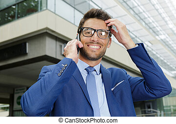 businessman in glasses looking at the camera