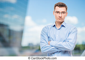 Businessman in glasses young and very successful,  in office