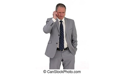 Businessman in gray suit having a phone call against a white...