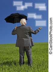 Businessman In Green Field Umbrella & Screens