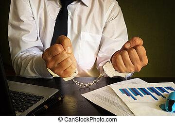 Businessman in handcuffs.