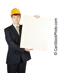 businessman in hardhat holding banner
