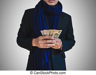 Businessman in holding cash