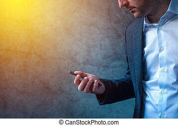 Businessman in hurry received SMS message on smartphone, man...
