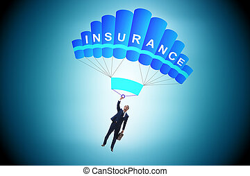 Businessman in insurance concept on parachute