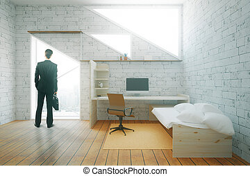 Businessman in interior with workplace