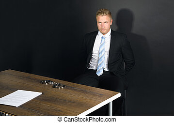 Businessman In Interrogation Room - Portrait Of Young...