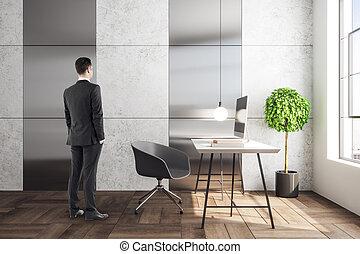Businessman in light interior