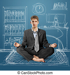 businessman in lotus pose meditating at the office