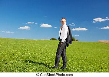Businessman in meadow