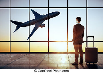 Businessman in modern airport interior